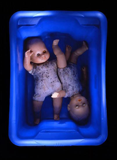 author: Jeremy Webb title: dolls in blue tub